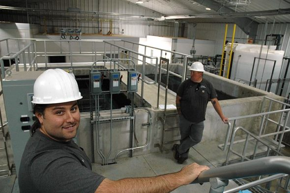 Brad Ault (left), Village superintendent of water and wastewater, said this week that the new water  plant will be in operation by the end of the year. Also pictured is John Christenson of the water and wastewater department. (Photo by Megan Bachman)