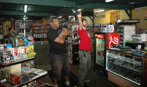 """Super-Fly Comics and Games celebrated its 10th anniversary Saturday, Sept. 2. Pictured here inside the store are owners Jared Whittaker, left, and Anthony """"Tony"""" Barry. Super-Fly sells comics, graphic novels, books, toys, action figures, board games, role-playing games and more. The store pulled in lots of fans Saturday, setting the record for its single biggest sales day ever. (Photo by Aaron Maurice Saari)"""