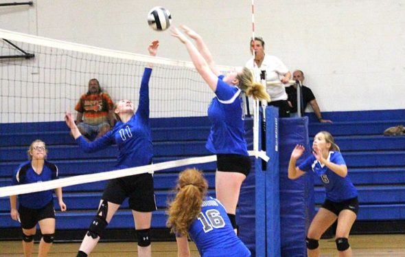 Junior Alex Ronnebaum went up for a block during the Yellow Springs High School girls varsity volleyball team's three-set win over visiting Middletown Christian on Sept. 5.  Ronnebaum —who has yet to commit a service error this season —served for seven points, six aces, and contributed seven kills, two blocks and four digs in the Bulldog victory. (Photo by Zack Brintlinger-Conn)