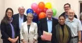 Pictured at the ceremony celebrating 30 years of the Village Mediation Program are mediators John Gudgel, Janet Mueller, Bruce Heckman, Marianne MacQueen, Jalyn Roe, Len Kramer, Staffan Erickson and Jane Scott, with Mayor Foubert. (Submitted photo)