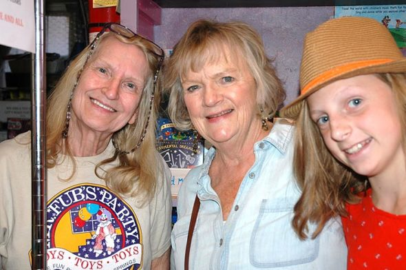Word that Mr. Fub's Party toy store is closing with the retirement of owner Priscilla Moore, left, brought longtime patron and former villager Donna McGovern into the shop with her granddaughter, Kennedy, this past weekend to wish Moore well. (Photo by Carol Simmons)
