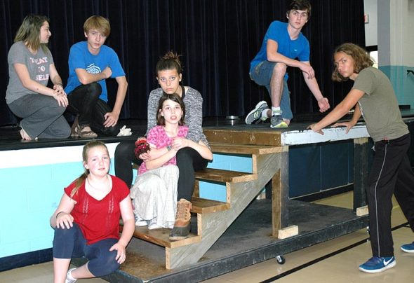 """The first Bulldog Theater Festival kicks off this weekend with """"The Last Lifeboat,"""" directed by Lorrie Sparrow-Knapp, which tells the story of the man who built, and then survived, the sinking of the Titanic. Shown above at a rehearsal are the principals, from left, top: Raina Kraus, Pete Freeman, Liam Hackett. Below: Keira Hendricks, Delia Hallett, Julia Hoff, and Elyah Naziri. (Photo by Diane Chiddister)"""