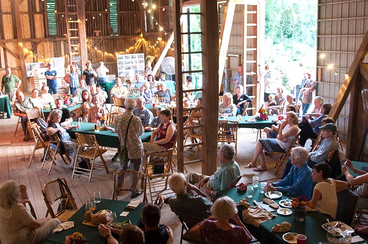 Locally based poet Ed Davis read some of his work during a community dinner in August to celebrate Community Solutions' Agraria project. The dinner, featuring locally sourced foods, was held in the property's 7,000-square-foot barn. (Submitted Photo)