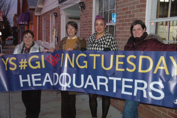 #YSGivingTuesday committee members, from left, Kathryn Hitchcock, Jeannamarie Cox, Dawn Boyer and Ara Beal, are preparing for the village's second year participating in the charitable giving campaign that falls on the Tuesday after Thanksgiving. While the initiative is focused on online giving, the local effort also will accept in-person donations from 8 a.m. to 8 p.m. Tuesday, Nov. 28, at the Yellow Springs Senior Center. (Photo by Carol Simmons)