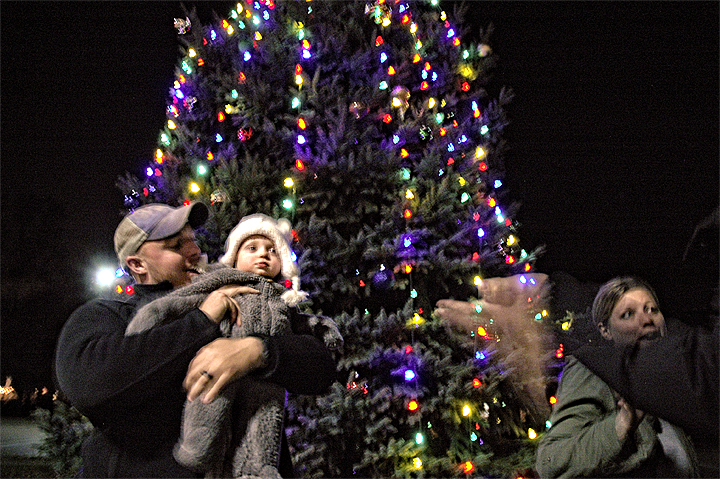 Present at the tree lighting ceremony were Assistant Village Manager Melissa Dodd, at right, husband Dalton and little Stella. (Photo by Matt Minde)