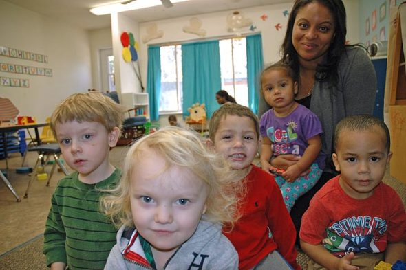 Malissa Doster, new director of the Yellow Springs Community Children's Center, paid a visit last week to the center's toddler room. Shown above are, in front, Soloman Cosby; from left, Finn Wallant, Dylan Carson, Isabella Lorenzo on lap (Doster's daughter), Doster and Kadence Sturdivant. (Photo by Diane Chiddister)