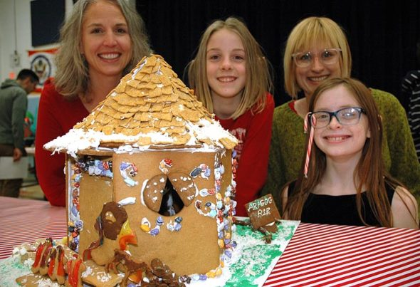 Hagrid's Hut won the People's Choice award, and won third place from the judges. Shown above are creators Monica Hasek, Olivia Hasek, Corrie Van Ausdal and Tiger Jane Collins, Van Ausdal's daughter. (Photo by Diane Chiddister)
