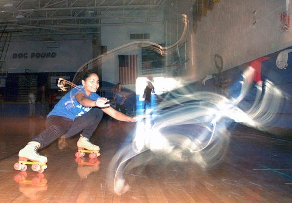 Shaylee Smith rolls with light ghosts, an artifact of the photo time exposure and disco lighting. (Photos by Matt Minde)