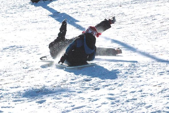 """Vaughn Hendrickson  and Noah Horn were two of the hardy sledders took to Gaunt Park Hill, attempting the ultimate quest of """"catching air"""" when shooshing over a hump of snow. (Photo by Matt Minde)"""