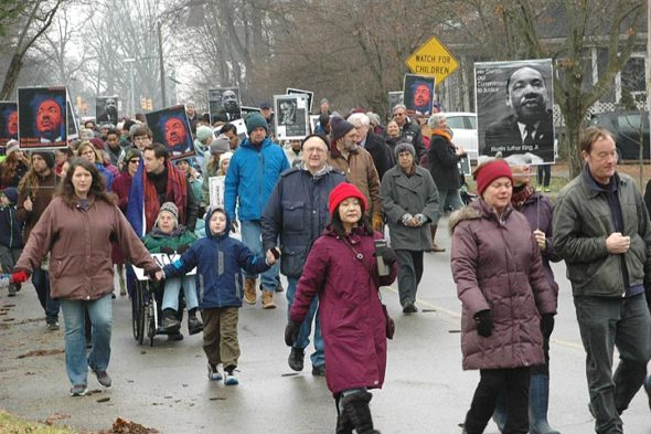 The local celebration of the birthday of civil rights icon Dr. Martin Luther King Jr. takes place on Monday, Jan. 15, at 11 a.m. at Bryan Community Center gym, a new location. Marchers will congregate at 10 a.m. in the Subway parking lot that day for the march downtown that precedes the event. Shown above is the 2017 MLK march, which was attended by hundreds although the weather was frigid. (News archive photo by Matt Minde)