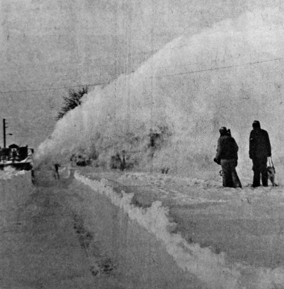 A heavy duty snow remover on loan from Wright-Patterson Air Force Base removes the village's largest snow drift along Enon Road.