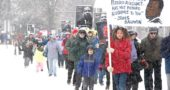 Several hundred villagers showed up in the cold and snow to march and honor Dr. Martin Luther King Jr. (Photo by Matt Minde)