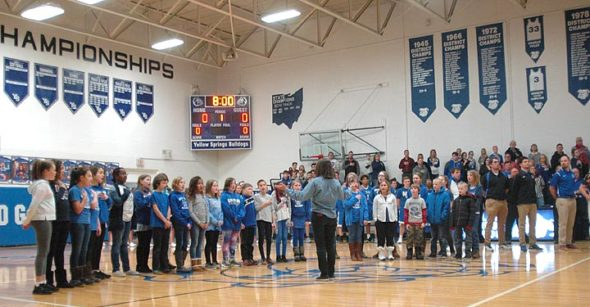 On Friday night, Jan. 19, the YSHS JV and Varsity boys basketball teams hosted Middletown Christian Eagles. Both teams lost to their rivals: JV, 40–30, varsity, 72–52. A bright spot between the games was the singing of the national anthem by the Mills Lawn School fifth and sixth Grade choir, directed by music teacher Jo Frannye Reichert. (Photo by Matt Minde)