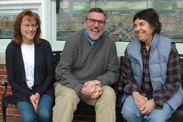 A new volunteer initiative called PORCH aims to collect food items from villagers' homes to donate to the Yellow Springs Community Food Pantry. The local PORCH effort is organized by Libby Hammond, left, with support from Pastor Rick Jones, of United Methodist Church, where the pantry is located, and the pantry's director, Paula Hurwitz. (Photo by Audrey Hackett)