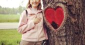"February is American Heart Month, and many don't know that heart disease is the No. 1 killer of women. Shown above, Lynda Terry of Yellow Springs, who suffered a heart attack in 2011, is shown at a ""heart"" tree on the bike path after she and her family completed a walk in support of the 1st Annual SCAD Research Walk/Run taking place that day. Terry's heart attack was caused by SCAD, or spontaneous coronary artery dissection, a rare coronary disease that strikes younger women. (Submitted Photo)"
