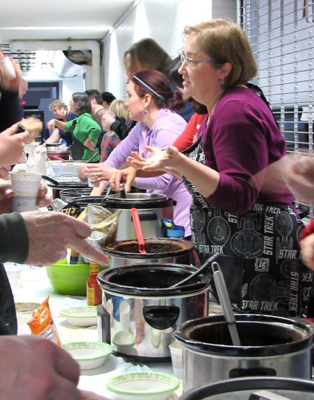 Lorrie Sparrow-Knapp, right, served up one of the 20 chilis on offer at last year's McKinney chili cook-off, an annual fundraiser for the eighth-grade trip to Washington, D.C. This year's cook-off is Saturday, Feb. 17, and includes a barn dance. (Submitted photo by Maria Booth)