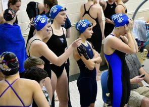 Yellow Springs High School swimmers Natalie Galarza, Aza Hurwitz, Jude Meekin and Eden Spriggs waited for an event at the recent Metro Buckeye Conference meet, where the girls won the Metro Buckeye Conference championship for the third year in a row. (Submitted photo by Kathleen Galarza)