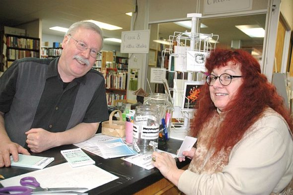 Xenia's Blue Jacket Books will close for good May 12, with a progressive sale beginning March 5. But Blue Jacket's popular in-store café, Tables of Contents, has no plans to close, according to owner Lawrence Hammar, pictured here with bookstore employee Yvonne Wingard. Bookstore and café are owned by Yellow Springers Hammar and his wife, Cassandra Lee, who operates the café. (Photo by Audrey Hackett)