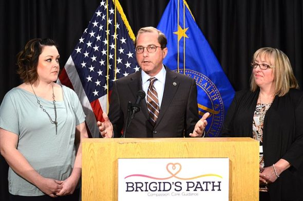 U.S. Secretary of Health and Human Services Alex Azar spoke at a treatment facility in Kettering for newborns suffering from opioid dependence on Friday. Flanking Azar is, left, foster mother Cyndi Swafford, and the center's founder and director Jill Kingston. (Photo by Megan Bachman)