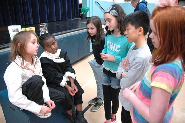 Second-graders Cruz Drew and Gianna Bunch portrayed notable African-American writer and educator Booker T. Washington, whose history and biography they studied, at the Jan. 26 Mills Lawn School Black History Month Living Museum.  (Photo by Matt Minde)