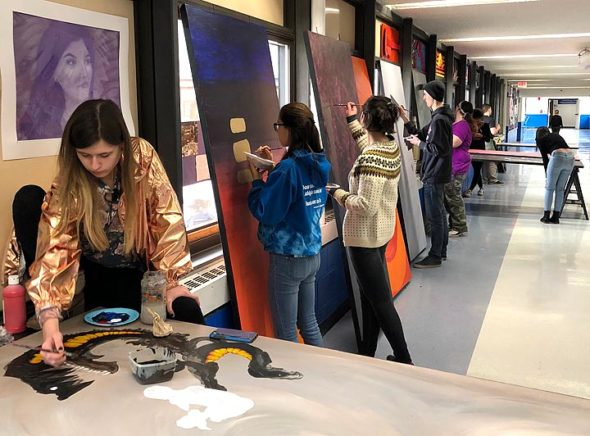 Art students are shown here creating large-scale panels, and health students are creating infographics to support the imagery and concepts. (Submitted Photo)