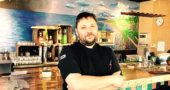 Brian Rainey, chef and owner of the Sunrise Cafe, recently opened the Calypso Grill on the south edge of town, in the former home of Dona Margarota's. The restaurant features Caribbean, Cuban and South American dishes. (Photo by Holly Hudson)