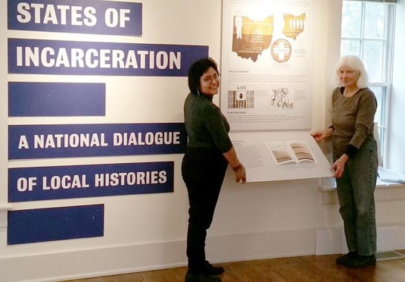 """Antioch College senior Odette Chavez-Mayo and alumna and Antioch Resident Scholar Dennie Eagleson recently helped install the college's panel in the nationally touring """"States of Incarceration"""" exhibition on display through June 2 at Antioch's Herndon Gallery. The faculty-mentored student research for this panel and book and online content was collaboratively created in Emily Steinmetz's fall course, Critical Prison Studies, with Antioch students and women serving life sentences at Dayton Correctional Institution. (Submitted Photo)"""