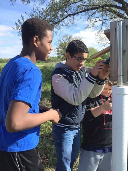 """Operation Bluebird, a collaboration between Yellow Springs Schools and Tecumseh Land Trust that puts McKinney Middle School seventh-graders in the role of """"Citizen Scientists"""" to monitor the activity at local nesting boxes, will resume this spring with a new crop of students. Pictured from last year, from left, are Aamil Wagner, Joaquin Espinosa and Jonathan Garrett. (Submitted photo)"""