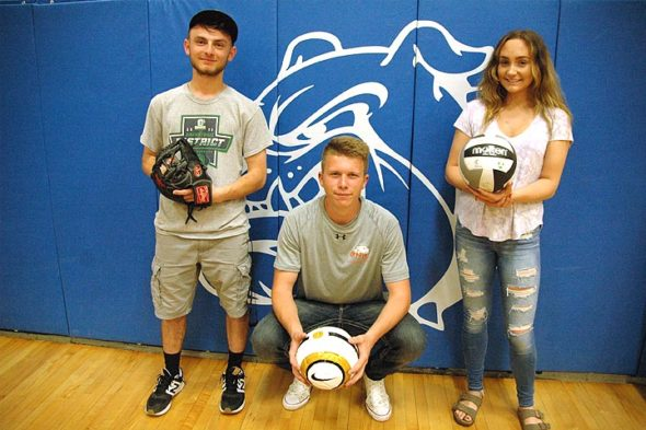 Three Yellow Springs High School athletes are headed to college next year in their respective sports. From left, Donnie Isenbarger will play baseball at Clark College in Vancouver, Wash., Fisher Lewis will play soccer at Ohio Northern University in Ada and Payden Kegley will play volleyball at Clark State Community College in Springfield. (Photo by Megan Bachman)