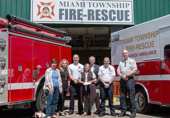From Left to right: Sandy McHugh, Rebecca Morgann, Fire Chief Colin Altman, TownshipTrustee Chris Mucher, Assistant Chief Denny Powell, and Firefighters Association President Bob Cooper. (Photo by Morgan Beard)