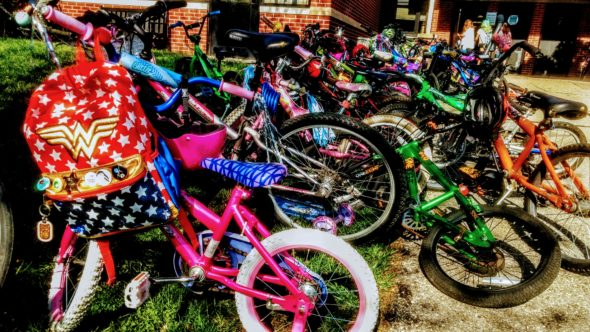 Bikes lined the sidewalks at Mills Lawn on May 9 for Bike to School Day, when Mayor Pam Conine made a proclamation in honor of the late Tracy Logan.