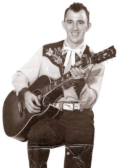 A famous musician with ties to the village is rock 'n' roll and country musician and producer Brien Fisher, here photographed with a Gibson CF-100 acoustic guitar sometime in the 1950s. Fisher was living on Livermore Street when he appeared on American Bandstand in 1957, and went on to become a successful Nashville producer. (Submitted photo courtesy of Kevin Fisher)