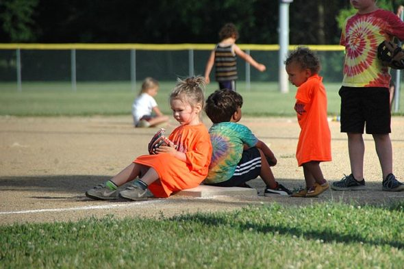 Base camp: From left, T-ball players Silas Lee, Luke Miller and Imogene Cowperthwaite take a break from Friday night's action. The Perry league meets at Gaunt Park every Friday night from 6:30 to 8 p.m. through the beginning of August. (Photos by Megan Bachman)