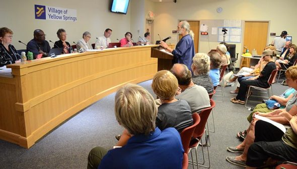 "Jeff ""Pan"" Reich addressed council members during the citizen's comment period of its July 2 meeting. Reich, along wiht eight other  villagers, expressed support for Cpl. David Meister, who is facing disciplinary charges. About 30 citizens attended. (Photo by Megan Bachman)"
