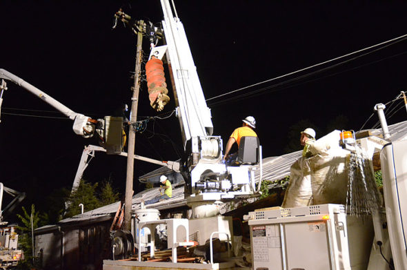 Village utility and Hi-Tech Electrical Contractors crews worked throughout the night Wednesday, July 18, to replace a centrally — and awkwardly — located utility pole in Kieth's Alley. (Photos by Matt Minde)