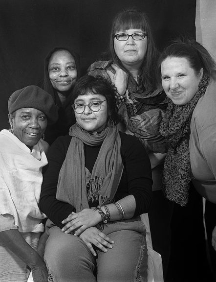 "Photographer and recent Antioch College graduate Odette Chavez-Mayo (center) posed with the imprisoned women who sat for the portraits in her exhibit, ""We are Enough: Women of Dayton Correctional Institute."" From left to right are DeRynda, Sista, Aurora and Serenity, pseudonyms chosen by the women, since their real names were not permitted to be used in the exhibit. ""We are Enough,"" which is showing at the Emporium, runs through August 5.  (Submitted photo by Odette Chavez-Mayo)"