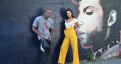 "Before the screening of her new feature film ""Blindspotting,"" at the Little Art Theatre, July 19, Actor Janina Gavankar and friend Dave Chappelle hung out in front of a mural of the musician Prince in Kieth's alley by local artist Sarah Dickens. (Photo by Robert Hasek)"