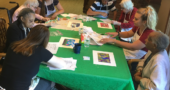 OMA volunteers work with Friends Care Community residents to create artwork. Pictured from left to right around the table are volunteer Madison Ryan, residents Dorothy Boyce and Dania Hayslip, volunteers Aliya Moss and Taggart Fox, resident BJ Ritchie, volunteer Victoria Critchley and resident Ermin Frey. (Submitted photo)
