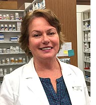 "Janice Blandford, head pharmacist at Town Drug for the past four years, says she is ""semi-retiring"" as she leaves the local drug store after 20 years off and on, and moves with her husband, Thad Tarpey, to New York City, where Tarpey has a new job. (photo by Robert Hasek)"