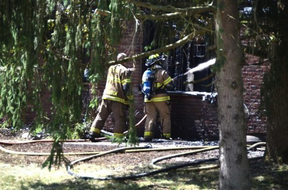 Firefighters worked to extingush a house fire at 1436 Glen View Drive on Friday, Aug. 24, that left a 26-year-old disabled man dead and his grandmother hospitalized. (Photo by Megan Bachman)f