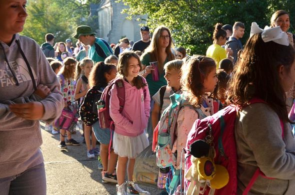 Mills Lawn second-graders lined up outside the school's front door on a sunny Friday morning, Aug. 24. (Photo by Carol Simmons)