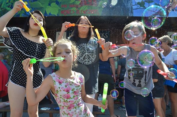 The sixth annual Bubblefest attracted bubble-blowers from near and far. Here local resident Ginger Spaugy enjoyed some good clean fun with her grandchildren, from left, Rayna, Jaidyn and Vanny. (Photo by Megan Bachman)