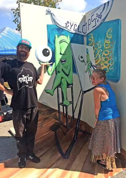 Christopher Weyrich and Tiffany Clark of Dayton's Mural Machine, pose with Weyrich's Cyclops Fest mural in 2016. (Submitted photo)