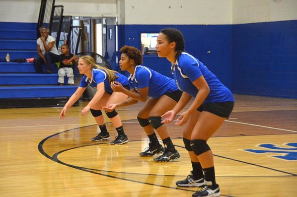 Olivia Snoddy, Annlyn Foster and Aaliyah Longshaw concentrate as they wait for a serve during the YSHS varsity volleyball team's home game Thursday, Aug. 30, against Middletown Christian. (Photo by Carol Simmons)