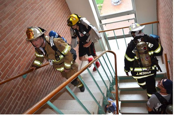Miami Township Fire-Rescue Chief Colin Altman, left, led local firefighters in organizing, and participating in, the fifth annual 9/11 Memorial Stair Climb at Antioch College last Saturday in the college's historic main building. (Photo by Megan Bachman)