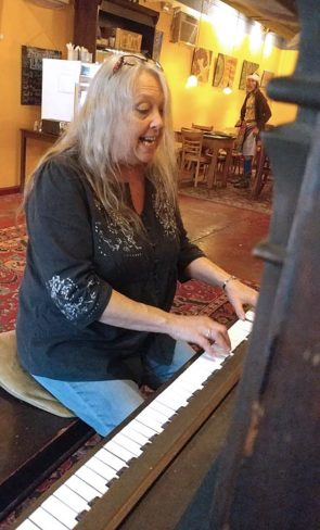 Sharon Lane, an organizer of this weekend's Fancy Fest music festival just outside of Yellow Springs, played a blues number in the Emporium this week. Lane, a singer-songwriter, is also one of the event's featured performers. (Photo by Tracy Perkins-Schmittler)