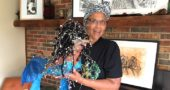 Deborah Dixon with a papier maché sea goddess and other original work in her home studio. (Photo by Carla Steiger)