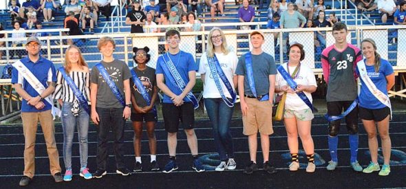 Court side: Yellow Springs High School celebrated homecoming on Friday, Sept. 14, with this year's homecoming court, which was announced between two soccer matches. Members of the elected court are, from left, teacher and Interim Assistant Principal Cameron McCoy, students Kayla Ross, Ian Sherk, Malaya Booth, King Trey Anderson, Queen Alex Ronnebaum, Ian Hawkins, Kenna Thomas and Dylan Rainey and teacher Kate Lohmeyer. Missing from the photo are Dezmond Wilson and Sumayah Chappelle. (Submitted photo by John Bombatch)