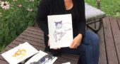 "Local author, illustrator and English professor Kate Polak recently showed off some watercolor paintings of cats as part of a children's book project. Polak recently authored, ""Ethics in the Gutter: Empathy and Historical Fiction in Comics."" (Photo by Carla Steiger)"