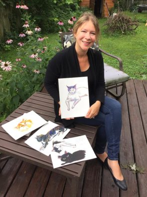 """Local author, illustrator and English professor Kate Polak recently showed off some watercolor paintings of cats as part of a children's book project. Polak recently authored, """"Ethics in the Gutter: Empathy  and Historical Fiction in Comics."""" (Photo by Carla Steiger)"""